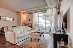 38 Joe Shuster Way Suite 307 listed by Jessica McLean offered for sale. Featuring 5 rooms, 2 bedrooms and 2 bathrooms at King and Dufferin.