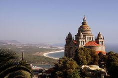 Viana do Castelo (Portugal). 'Whether glimpsing the waves from the tower of Monte de Santa Luzia or riding them on your kiteboard at Praia de Cabedelo, it's hard not to love the jewel of the Costa Verde. The cobbled fishing quarter is rough around the edges, but sprinkled with the some of the finest seafood kitchens in the country. And fun-loving university students rule the night.' http://www.lonelyplanet.com/portugal/the-north/viana-do-castelo/sights/hill/monte-santa-luzia