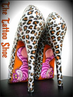 I hate leopard, but I love the Cheshire Cat, if i was plain black or white with blue behind the cat it would look amazing