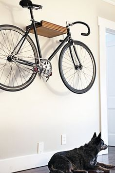 Bike shelf- because hanging a bike by two hooks get too complicated and causes the bike to scratch the wall.