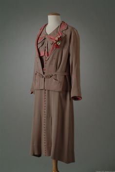 Three piece suit of beige/gray satin backed crepe with accents of red and white checkered taffeta. Object Number 06_02_33 Date Made 1933 Designer Hoyt, Peggy