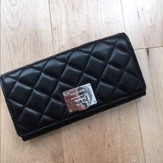 Michael Kors Astrid Quilted Wallet Softest leather ever! Carry all wallet has zipped compartment and many credit card slots. Hard to find.  Black with silver. No trades! MICHAEL Michael Kors Bags Wallets