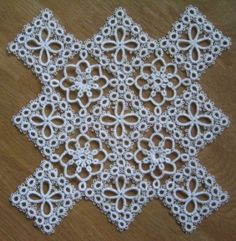 Ann Brunvold/Nuperelle's antimacassar:  Do you know what an antimacassar is?  Yes, you would tat/crochet a piece of lace to keep men's HAIR OIL from ruining your furniture.  Omgosh, can you imagine all that WORK for hair oil?