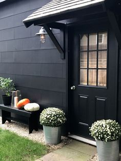 A DIY Portico and everything painted Behr paint BLACK! Come see how we made the portico. Portico Entry, Garage Door Design, Portico, Door Awnings, Interior Barn Doors, Door Overhang, Garage Door Types, Beach House Decor, House Exterior