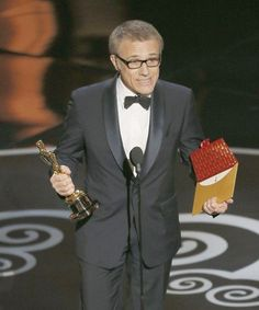 """Christoph Waltz accepts his Oscar for supporting actor for his performance in \""""Django Unchained.\"""" It's his second Academy Award; he won in the same category for another Quentin Tarantino movie, \""""Inglourious Basterds."""