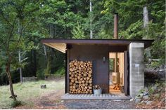 On Salt Spring Island in British Columbia lies a tiny one-room cabin, a finely detailed retreat from Seattle-based Olson Kundig Architects.  Above: The cabin requires few storage spaces; firewood is stacked neatly on the back porch.