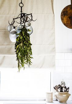 Hanging enamelware on hooks in the kitchen - Photographed and styled by ©Kara Rosenlund www.kararosenlund.com