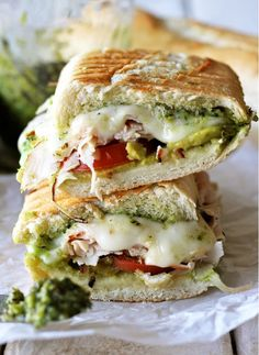Thanksgiving Leftovers - Leftover Thanksgiving Turkey Pesto Panini - This fully loaded panini is made with French bread, mozzarella, tomatoes, avocado, and of course, Thanksgiving turkey. An Italiano take on American cuisine. http://damndelicious.net/2012/11/21/leftover-thanksgiving-turkey-pesto-panini/