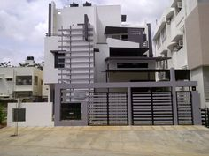Srinivasan's Bungalow Front Elevation Design - Actual site view of Bungalow Designs by Ashwin Architects in Bangalore.    Call (+91)-(80)-26612520 for more inforamation or visit http://www.ashwinarchitects.com
