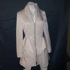 Bebe White peblar zip front dress coat Simply sophisticated and sassy, this gorgeous white subtle front ruffle zip up dressy trench can be worn to a day at the office,lunch with the girls, or even a night in the big Apple.  Sassy sophisticated and sultry...dress up or dress down but look fabulous all around. bebe Jackets & Coats Trench Coats