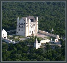 Falkenstein Castle in Burnet, Texas, built using plans for a Bavarian castle. I think you might have to pretend you want to get married there to get a tour.
