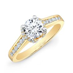 This stunning 14k yellow gold engagement ring  features channel set diamonds…