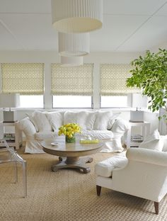 living rooms - Kelly Wearstler Imperial Trellis Citrine Fabric West Elm Parsons End Table Kartell Ghost Chair roman shades fiddle leaf fig plant white slipcover rolled-arm sofa white shag pillows wood pedestal coffee table