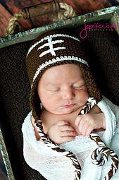 http://www.ravelry.com/patterns/library/free-baby-football-hat-crochet-pattern