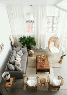 spacious living room // natural color living room // high ceilings