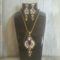Necklace and earring set Brand new 15 inch gold chain  pink green and rhinestone  necklace and earring set surrounded in gold. Jewelry Necklaces