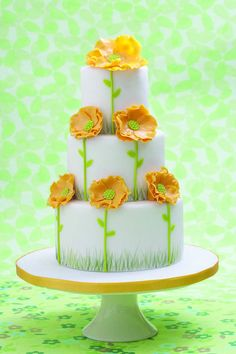 yellow poppi wedding cake-Except with 2 layers instead of 3...since we're probably going to have petit fours