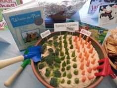 "How cute is this! Selima created a ""Rabbit's Garden"" for ""Winnie the Pooh"" with hummus and veggies. I added the food labels. She found kids size garden tools to add to the setting."