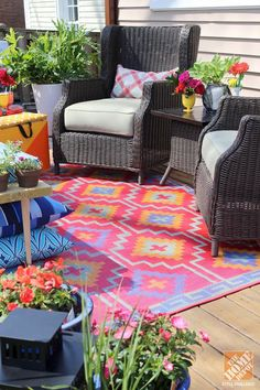 Patio Makeover Ideas: Lots of potted flowers for color. And a colorful outdoor rug. And MORE color. See photos of this knockout patio on The Home Depot Blog.
