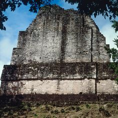 "(Tikal Temple VI, back of roof comb, Photograph by Jorge Pérez de Lara) ""...The oversized inscription that runs down the back and sides of Tikal Temple VI—featuring the largest glyphs in the Maya world—presents many problems of interpretation, although most of them a simple consequence of its highly dilapidated condition..."""