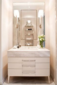 Guest Bath + Perfect Storage & Sleek Finishes + Dresser Vanity Sink & Sconces + Powell & Bonnell Design