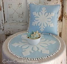 I just love this!! So simple and beautiful! Wool applique snowflake. ( I agree and love the pompom idea too).