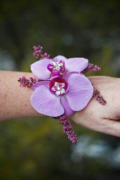Purple phalaenopsis orchids with rhinestones, make a beautiful prom wrist corsage Wrist Corsage Wedding, Wedding Bouquets, Prom Flowers, Silk Flowers, Phalaenopsis Orchid, Orchids, In Bloom Florist, Corsages, Boutonnieres