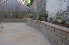 Natural sandstone walling with sandstone paving