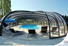The telescopic pool enclosures by Inter Pool Cover Group (IPC Group) enable you to get pleasure from your swimming pool in the very best and worst of climate Swimming Pool Enclosures, Swimming Pools Backyard, Pool Spa, Swimming Pool Designs, Outdoor Pool, Indoor Outdoor, Outdoor Living, Piscina Spa, Modern Pools