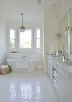 Stunning bathroom features built-in shelf under bay window accented with tub fuller paired with ...