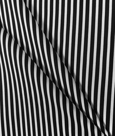"Premier Prints Carrie Black/White Fabric Buy 25 or more, pay $7.15 per yard Buy 50 or more, pay $7.00 per yard Material: 100% Cotton Duck Horizontal Repeat: 9/16"" Stripes are 1/4"" and 5/16"" Wide"