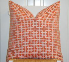 Please choose a size at check out.  (Pictures shown in 20 x 20)    This listing is for ONE decorative pillow cover. Made from upholstery weight home décor fabric with a beautiful geometric design.  Design is centered. Colors included Orange (papaya) with the look of embroidered design in ivory.    Backing is Upholstery weight cotton twill fabric in a creamy ivory.  Finished with an invisible zipper closure at the bottom.  All edges are overlocked for a clean finish.    Dry clean recommended…