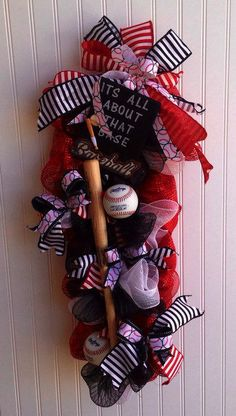 Baseball wreath/swag deco mesh swag for all you baseball lovers it has 2 real baseballs and a miniature baseball bat it has a chalkboard sign that says its all about that base it measures 32 in long 12 in wide 8 in deep this can be done in any colors to show your school spirit