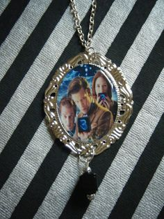 The Power of 3 Doctor Amy and Rory cameo necklace by indieodyssey, $8.00