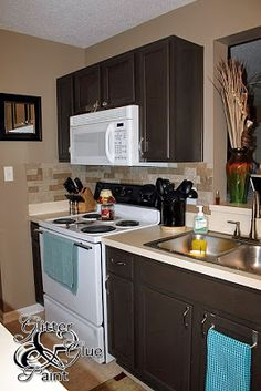 Pictures Of Painted Kitchen Cabinets how to paint ugly oak strip cabinetry | wood trim, hardware and