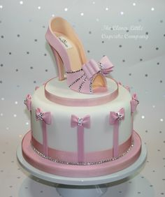 "Pink Shoe Celebration Cake - 8"" celebration cake with sugar shoe, studded with Swarovski crystals."