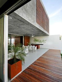 Transition of wood plank floor to terazzo.  Casa Xamantan | AS Arquitectura