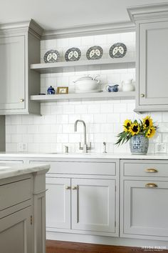 Like the cabinets, white counter and tile backsplash.  No brass handles.  Want dark harware and apron sink.