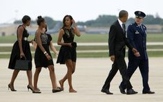 President Barack Obama speaks with Col. John C. Millard, Commander, 89th Airlift Wing, accompanied by his daughters, Malia and Sasha, and first lady Michelle Obama, upon their arrival at Andrews Air Force Base in Md., on Saturday, Aug. 30, 2014, en route to Westchester County, N.Y., to attend the wedding ceremony of White House Chef Sam Kass and MSNBC host Alex Wagner.