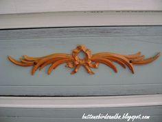 orange painted detail on dresser.