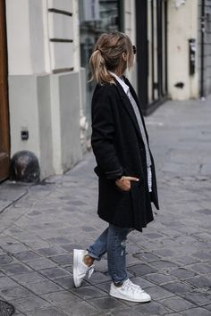 Black coat, grey sweater, white shirt, blue jeans & Stan Smith trainers | @styleminimalism