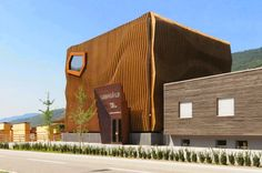 Staggering Wood Facade Appears as Rippling Waves on an Office Building