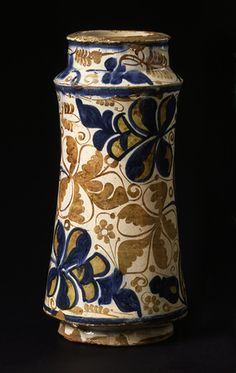 Earthenware albarello, painted in blue in, and with two tones of luster over, an opaque, white glaze  Manises, Spain; 1st half of 15th century