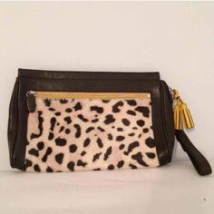 Coach Ocelot Haircalf Clutch Special Edition! Beautiful brown leather, large size Coach clutch. Measurement 10 1/2(L)''x 7(H)'' x 2(D)'' Excellent Condition, stored in Coach cloth bag. Coach Bags Clutches & Wristlets
