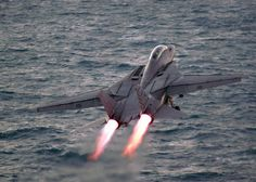 US Navy Tomcat assigned to Checkmates of Fighter Squadron Two One One launches from flight deck F14 Tomcat, Us Navy, Air Fighter, Fighter Jets, Air Force, Uss Enterprise Cvn 65, Photo Avion, Aircraft Photos, Military Jets