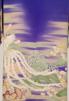 """1912-1926 (Taisho era). This striking blue silk furisode has designs created by the """"yuzen"""" (paste-resist method of dyeing) technique. The cranes and some flower designs are highlighted with both satin stitch and Sagara embroidery (knot embroidery). The pattern continues inside the lower inner lining and the upper inner lining is red silk. This kimono is said to have been brought to the US in the 1940s by a US Military Governor and diplomat who lived in Japan after WWII to help restoration."""