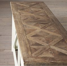 RH's Parquet X-Brace Console Table:We topped a substantial, trestle-style table with intricate elm parqueterie – a woodworking technique created to impress nobility at the 17th-century French court. Its clean, linear design gives it an elegant simplicity.
