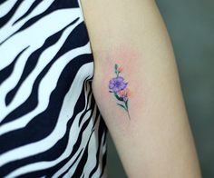 Small floral tattoo by Lone Wolf Studio