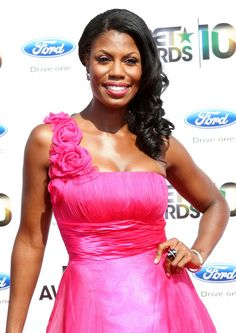 Omarosa looked ready for the prom in a floral pink gown and side-swept curls.