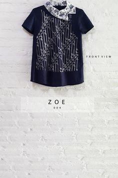 Asymmetric Semi-Satin Batik Parang Combination Collared Blouse  Length of Blouse : 59.5 cm.  Material Used : Batik Cap Parang, Cotton. Premium Navy Blue Cotton. Collar, Jacquard Fabric.  Standard Zipper Length (50-55cm) at the back